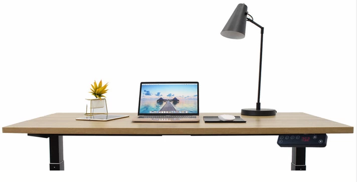 Laptop and other Work Essentials on the Stance Executive Electric Desk Dual Motor